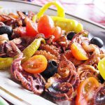 mixed fish plate with onions and peppers